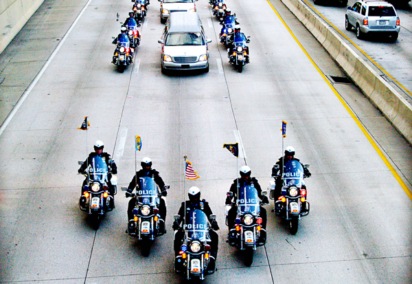 The funeral procession of Philadelphia Police officer Charles Cassidy of the 35th District. He was gunned down in the doorway of a Dunkin' Donuts while responding to a robbery on October 31st, 2007. It was the first of a rash of police shootings in Philadelphia that occurred over the next few months. (Gwyneth MacArthur/Flickr)