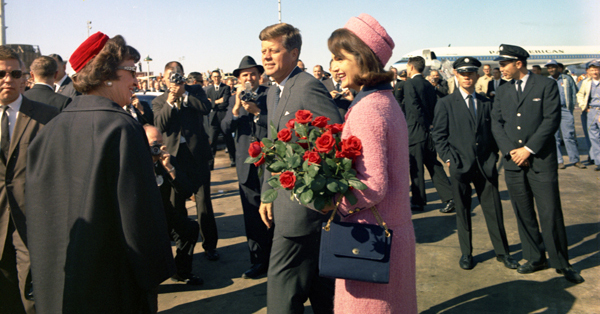 President and Mrs. Kennedy arriving at Love Field in Dallas, the morning of November 22, 1963; an hour after this photo was taken, JFK was dead. (Cecil Stoughton/JFK Presidential Library and Museum)