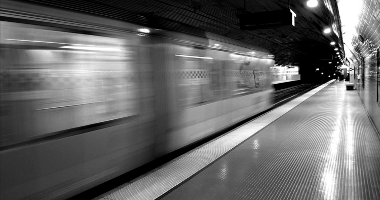 A black and white photograph of a subway car